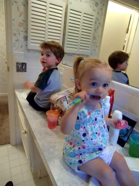 Kids Sitting on the Sink