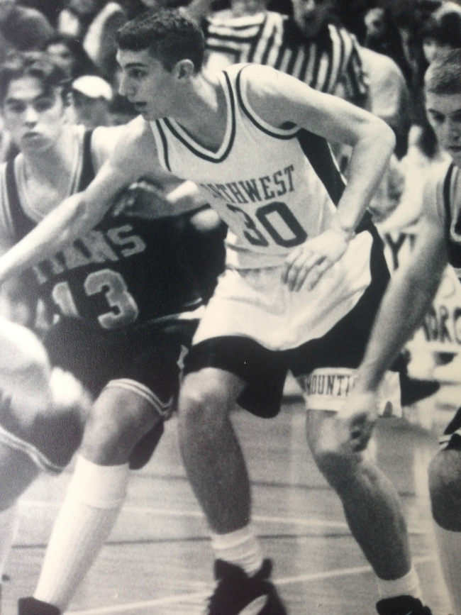 Nick playing basketball in high school