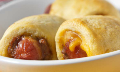 Add a twist to pigs-in-a-blanket with this coneys in a blanket recipe with Cincinnati-style chili. They'll be gone in minutes!