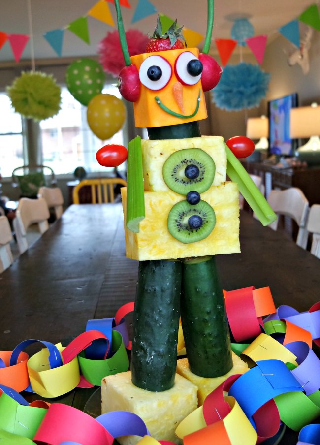 Looking for great kids birthday party ideas? This robot made out of fruit and vegetables is SUPER simple and fun to make - and is a great addition to EVERY party! Serve a produce robot at your next birthday party for kids or bring it to your next picnic!