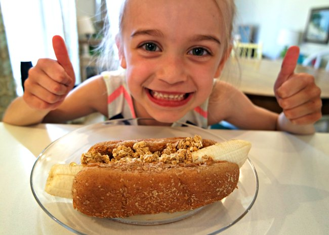 Looking for great breakfast, lunch and snack ideas that will keep your kids healthy and energized? You'll love these granola, peanut butter banana dogs. They're my daughter's favorite - and they're SO easy to make! Perfect lunch idea for kids!
