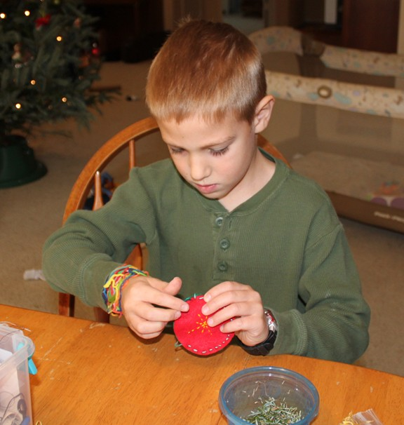 Check out these 15 DIY ornaments for boys to make this Christmas season! These are perfect ornaments to trim the tree or to give as gifts
