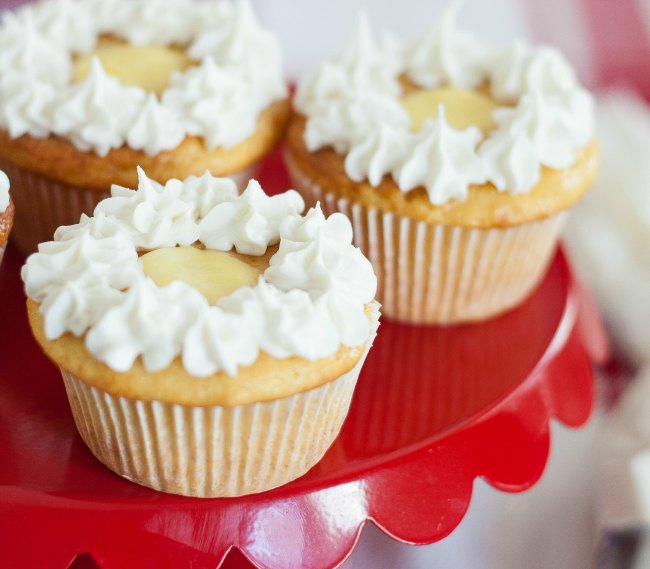 Looking for a fun new recipe for dessert? Featuring cream cheese frosting and a sweet pineapple center, these pineapple cinnamon cupcakes can be easily prepped for any party or cookie tray. You'll love the flavor of the cinnamon mixed with pineapple, and it's sure to become one of your favorite desserts.