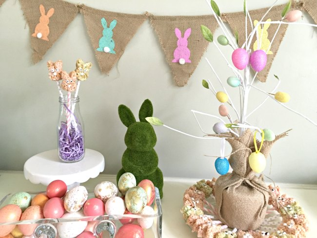 These easy Easter Bunny Pops are the perfect Rice Krispies treats on a stick. This fun Easter dessert combines an Easter craft into dessert. If you're looking for simple Easter ideas that can double as Easter decorations, look no further than these simple bunny pops.