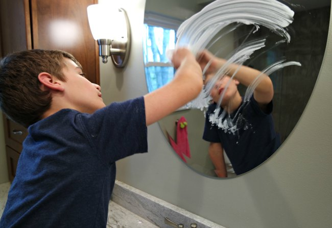 Want your kids to clean the bathroom - and really get it sparkling? These 6 clean bathroom hacks will have your shower doors sparkling and your kids checking things off their chore list. Great tips and tricks for teaching kids how to clean.