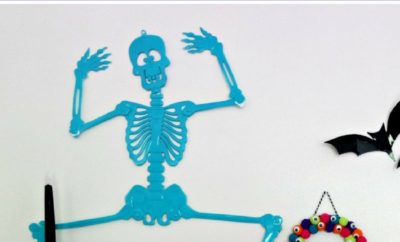 Head to your nearest Dollar Store or Dollar Tree to make these easy DIY skeleton Halloween decorations. Whether you're throwing a party or just decorating your house for Halloween, these cheap painted skeletons work as indoor decor, outdoor decor, or they're the perfect thing to hang on your door. Do a craft project with the kids, or DIY it yourself. And Happy Halloween.