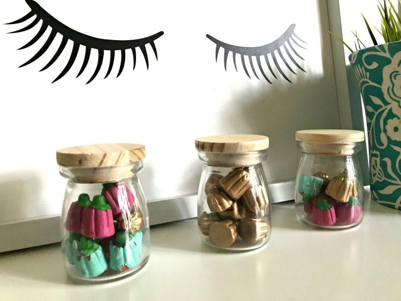 Painted Baskets On White Shelf