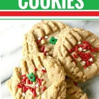 These gluten free, dairy free Christmas cookies are super simple to make and have only THREE ingredients. They're finished in just 12 minutes (that includes bake time), and they're delicious. A great recipe to make with kids and for your cookie exchange. Whether you're making them to celebrate the holidays, or you just want a yummy dessert, this Christmas cookie recipe is perfect. #christmas #cookie #dairyfree #glutenfree #cookingwithkids #cookieexchange #peanutbutter #simple #3ingredients